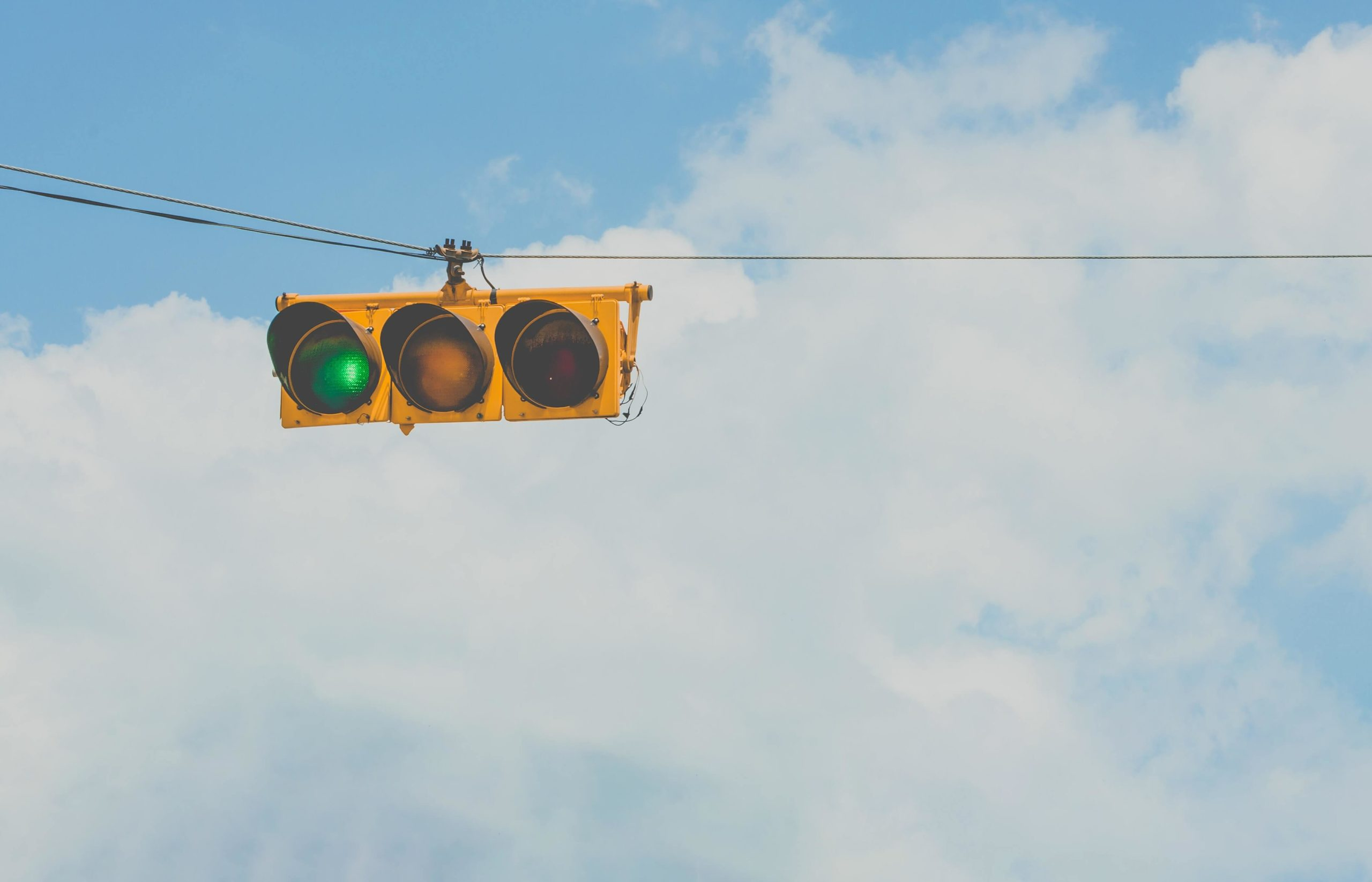 A traffic signal with a green light, which signifies loan officers can speed up the mortgage process.