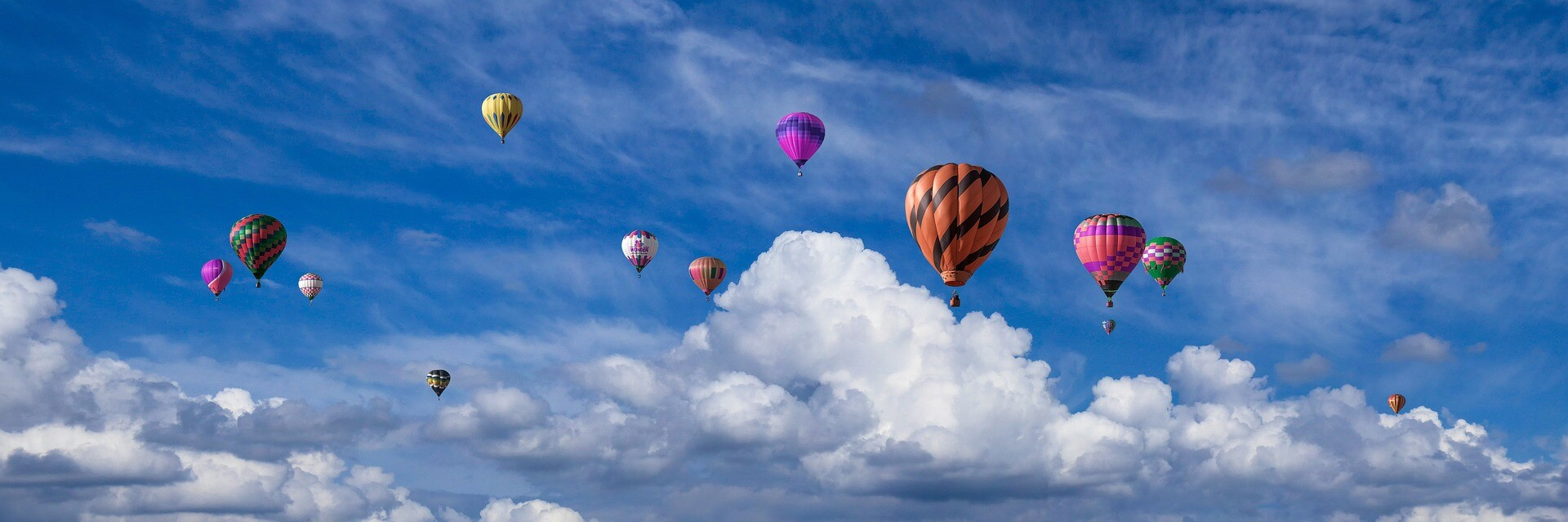 An image showing hot-air balloons flying high, like loan originators after reading this blog.